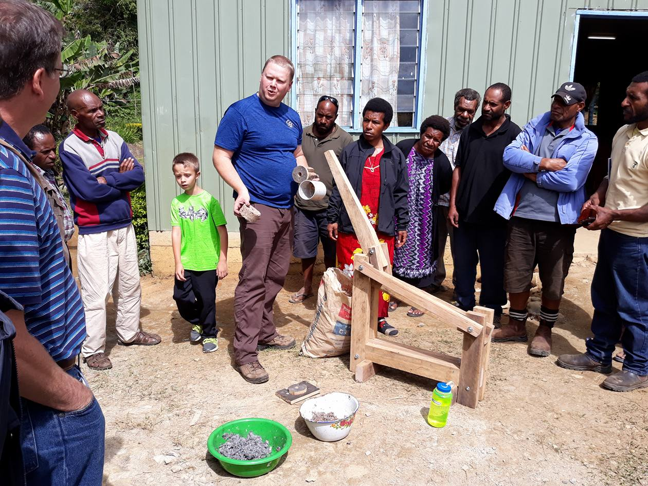 Teaching How to Use a Briquette Press